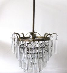A FOUR TIER CRYSTAL DROP CEILING LIGHT